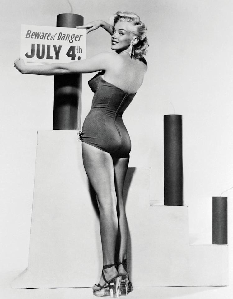 """<p>Marilyn Monroe, advises to """"Beware of Danger"""" while celebrating on the Fourth of July in 1953.</p>"""