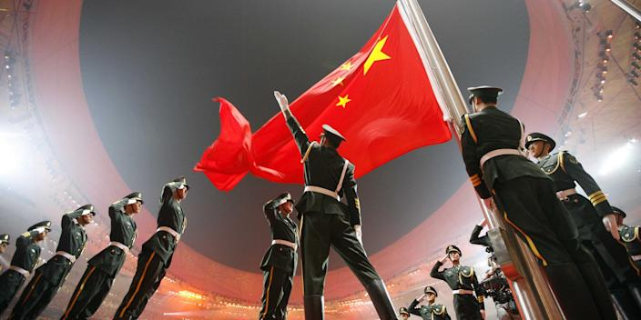 China's flag is raised during the opening ceremony of the 2008 Beijing Olympic Games.