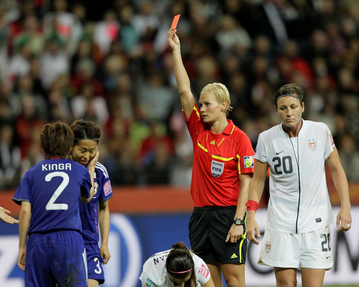 FILE PHOTO: Referee Bibiana Steinhaus (2nd R) of Germany shows a red card to Azusa Iwashimizu (2nd L) of Japan during the Women's World Cup final soccer match between Japan and the U.S. in Frankfurt, Germany July 17, 2011. REUTERS/Wolfgang Rattay/File Photo