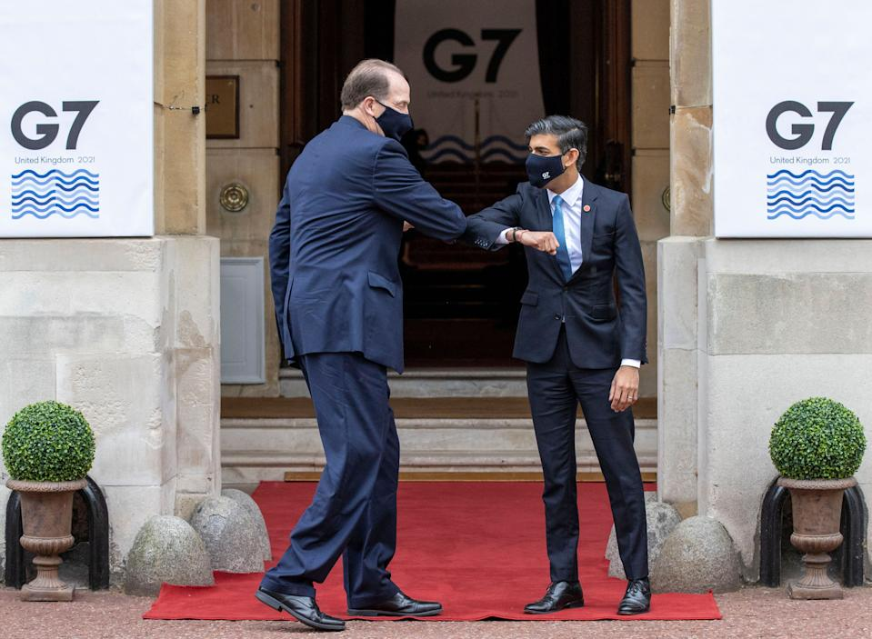 Britain's Chancellor of the Exchequer Rishi Sunak (R) welcomes President of the World Bank Group David Malpass to the G7 Finance Ministers Meeting at Lancaster House, central London on June 4, 2021. - Group of Seven (G7) finance chiefs gather this week to hammer out an agreement on corporate tax harmonisation aimed at raising revenues as economies recover from the coronavirus pandemic. (Photo by Steve REIGATE / POOL / AFP) (Photo by STEVE REIGATE/POOL/AFP via Getty Images)