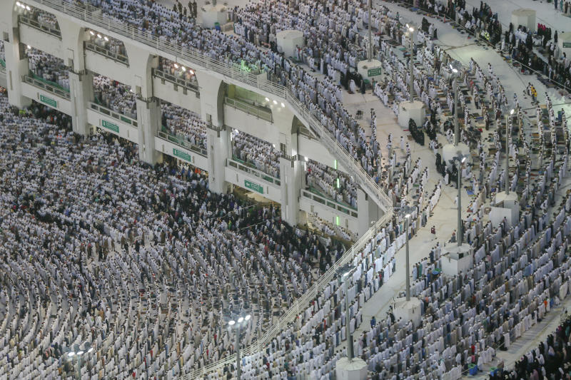 Muslim pilgrims pray at the Grand Mosque, ahead of the annual Hajj pilgrimage in the Muslim holy city of Mecca, Saudi Arabia, Saturday, Aug. 18, 2018. The annual Islamic pilgrimage draws millions of visitors each year, making it the largest yearly gathering of people in the world. (AP Photo/Dar Yasin)