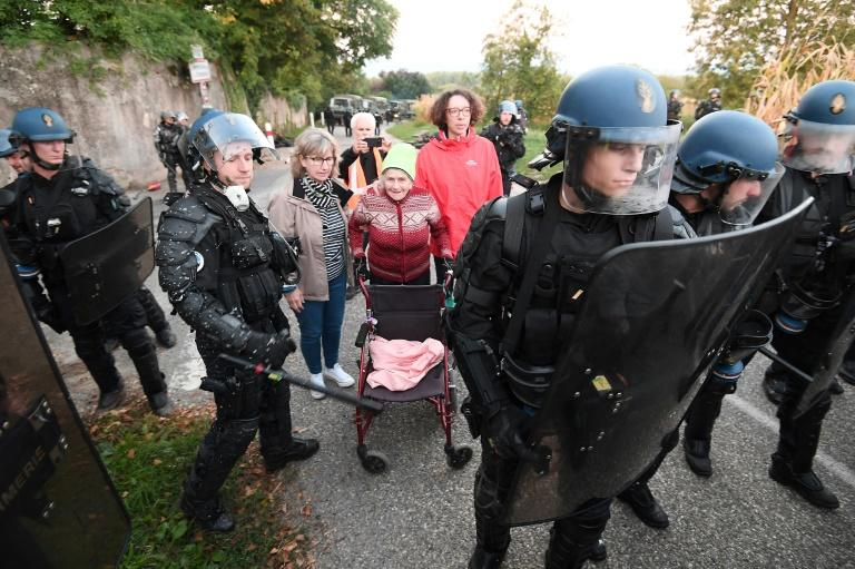 Police moved in to disperse the eco-activists protesting a new motorway section in Kolbsheim, eastern France, on Monday
