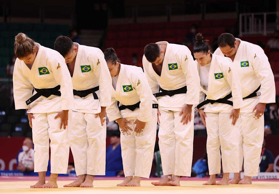 TOKYO, JAPAN - JULY 31: Team Brazil bow as they prepare to face Team Netherlands during the Mixed Team Quarter Final on day eight of the Tokyo 2020 Olympic Games at Nippon Budokan on July 31, 2021 in Tokyo, Japan. (Photo by Harry How/Getty Images)