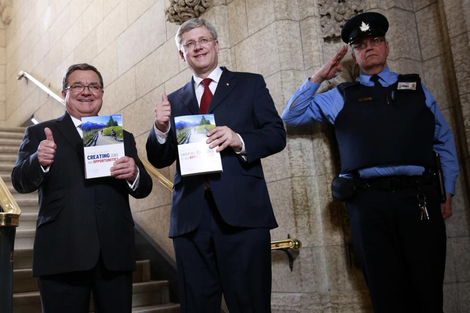 Canada's Former Prime Minister Stephen Harper (C) and Finance Minister Jim Flaherty walk to the House of Commons to deliver the budget on Parliament Hill in Ottawa February 11, 2014. (Reuters)