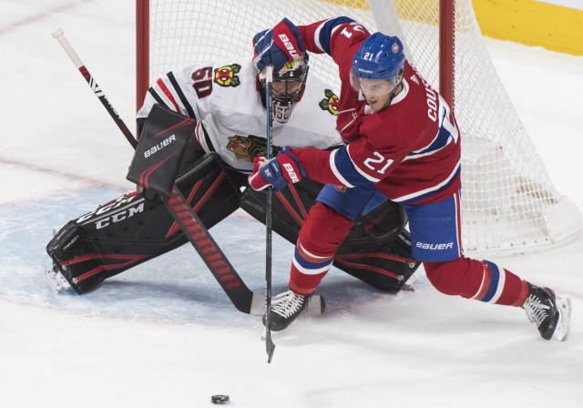 Montreal Canadiens' Nick Cousins moves in on Chicago Blackhawks goaltender Corey Crawford during the second period of an NHL hockey game Wednesday, Jan. 15, 2020, in Montreal. (Graham Hughes/The Canadian Press via AP)