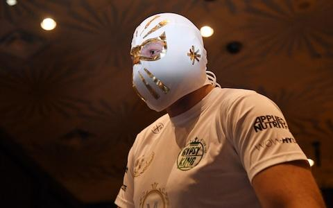 <span>Fury is never scared of mixing things up, this time donning a lucha libre mask ahead of entering the ring to work out</span> <span>Credit: Getty Images </span>