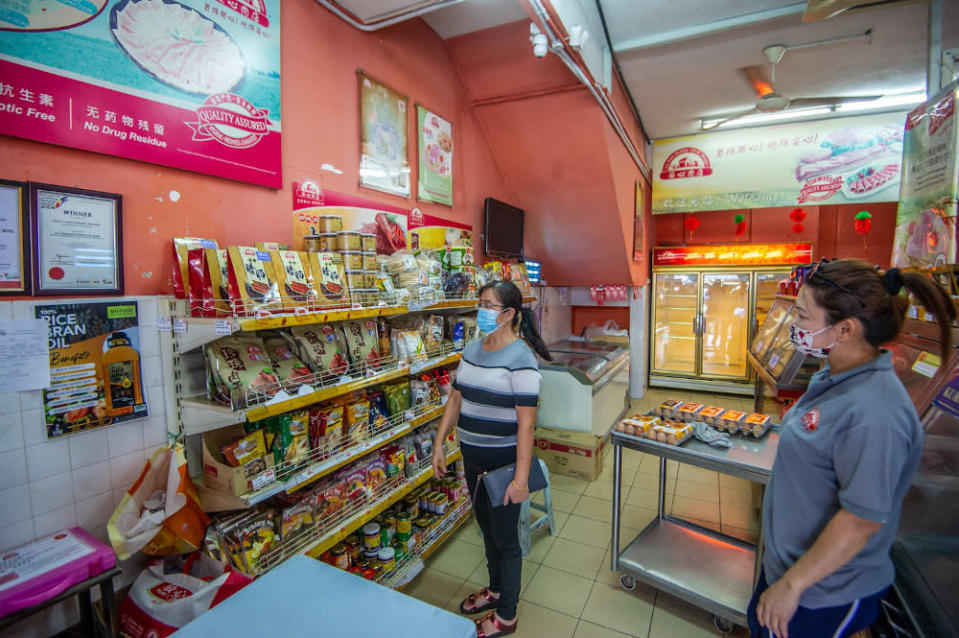 Customers browsing Chinese sausages and Bakkwa (Chinese pork jerky) at An Xin's Healthy Meat Shoppe in Taman Yulek, Cheras on Chinese New Year Eve, February 11, 2021. — Picture by Shafwan Zaidon