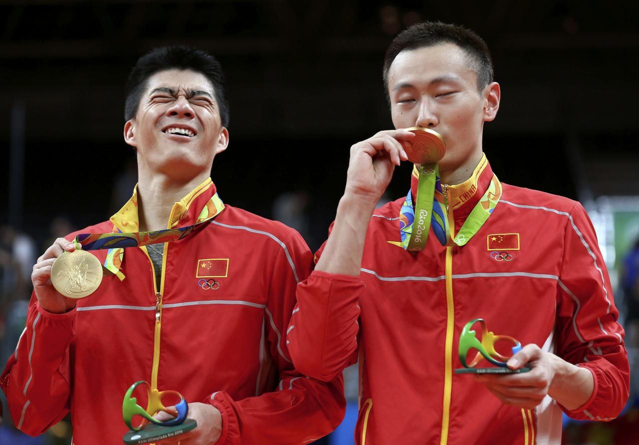 China edge Malaysia to take Olympic men s doubles badminton gold