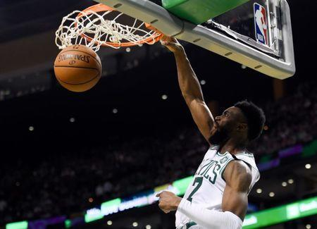 May 15, 2018; Boston, MA, USA; Boston Celtics guard Jaylen Brown (7) dunks and scores against the Cleveland Cavaliers during the third quarter in game two of the Eastern conference finals of the 2018 NBA Playoffs at TD Garden. Mandatory Credit: Bob DeChiara-USA TODAY Sports