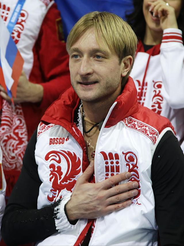 Evgeny Plyushchenko of Russia gestures as he waits for his results in the men's team short program figure skating competition at the Iceberg Skating Palace during the 2014 Winter Olympics, Thursday, Feb. 6, 2014, in Sochi, Russia. (AP Photo/Darron Cummings, Pool)