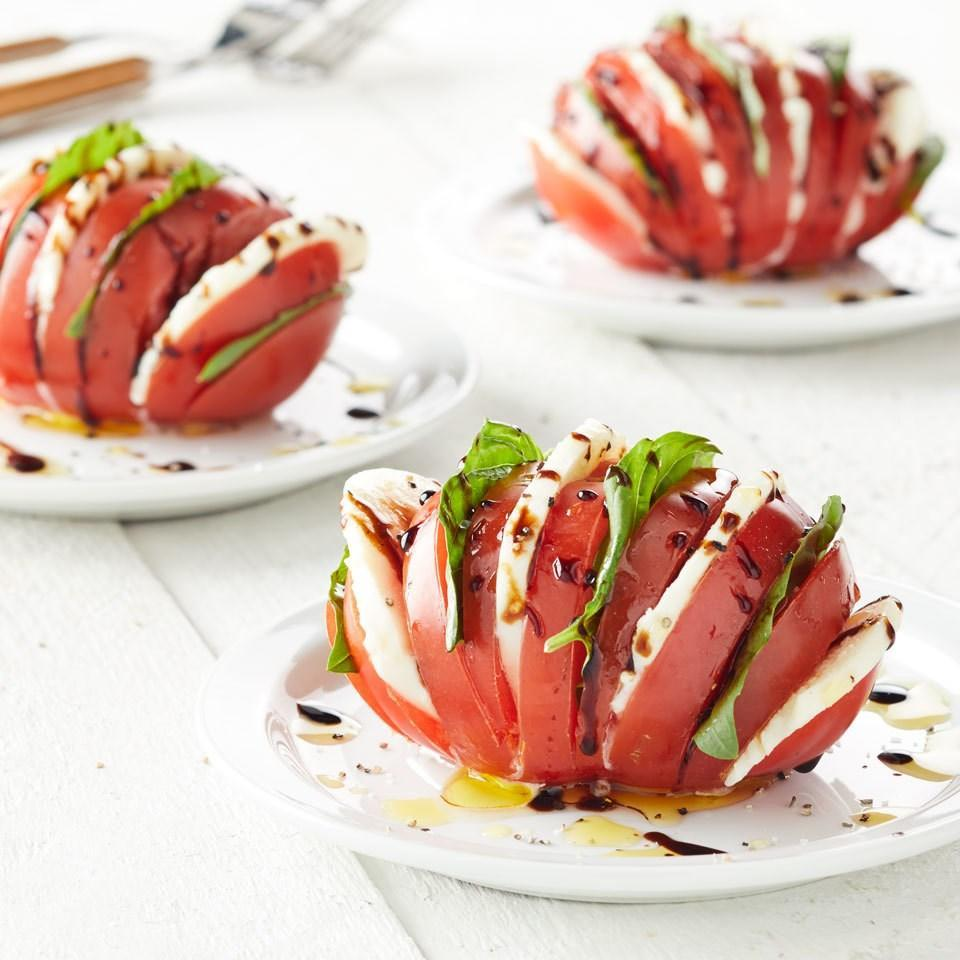 <p>Use the hasselback technique to upgrade plain caprese salad with this fun twist! Cutting partially into the whole tomato creates openings to layer in fresh mozzarella cheese, basil and a balsamic drizzle for tons of flavor in this unique vegetable side dish recipe.</p>