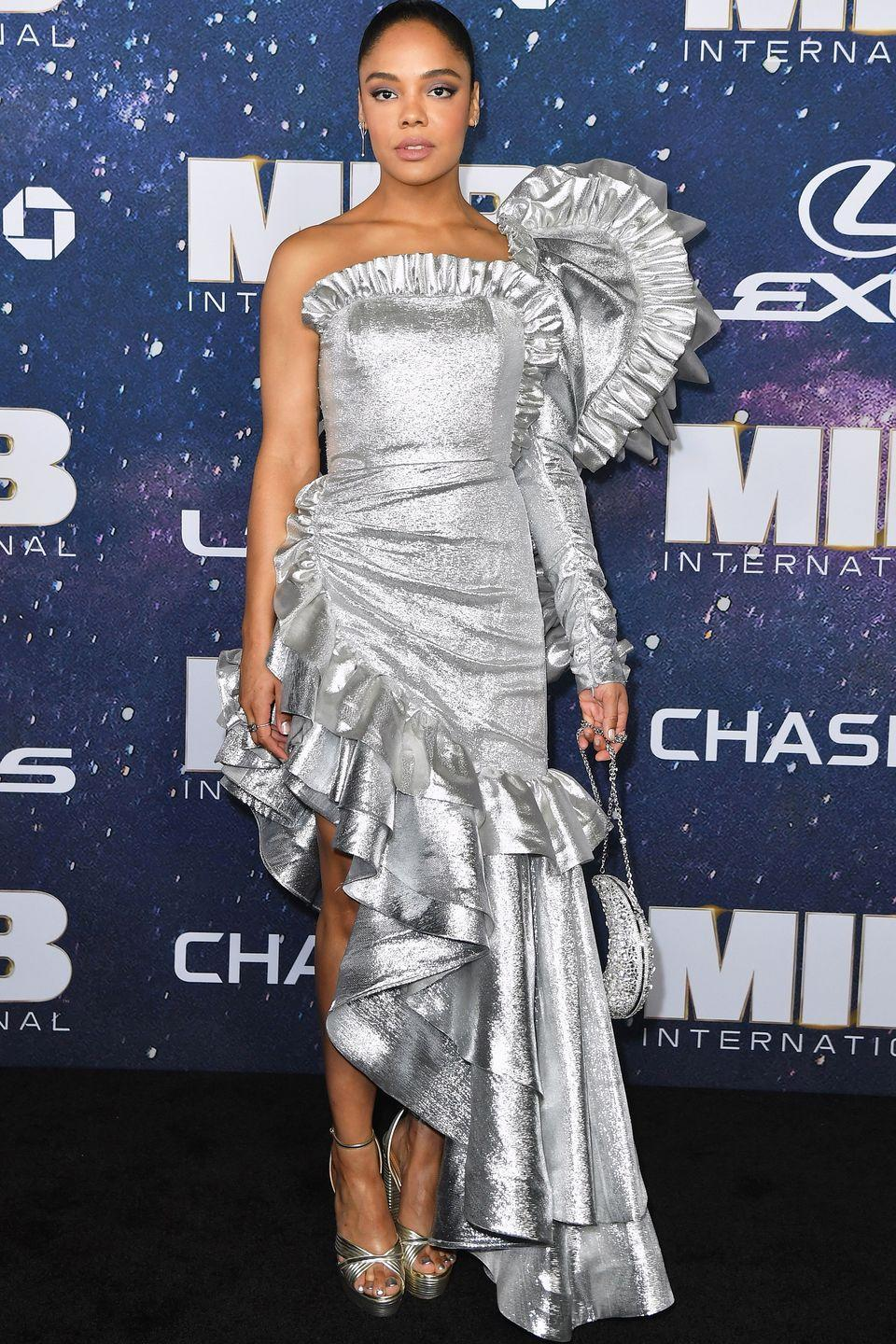 <p>Who: Tessa Thompson </p><p>When: June 11, 2019</p><p>Wearing: Rodarte</p><p>Why: Tessa Thompson's metallic gown at the <em>Men In Black: International </em>premiere in NYC puts the <em>extra</em> in extraterrestrial. Her look alone could save us from an alien invasion, winning best dressed of the week. </p>