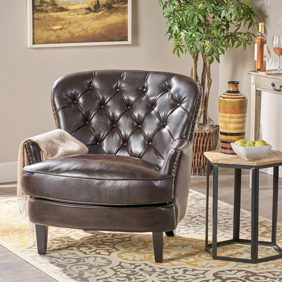 """<p><strong>Noble House</strong></p><p>walmart.com</p><p><strong>$242.50</strong></p><p><a href=""""https://go.redirectingat.com?id=74968X1596630&url=https%3A%2F%2Fwww.walmart.com%2Fip%2F55576779&sref=https%3A%2F%2Fwww.thepioneerwoman.com%2Fhome-lifestyle%2Fdecorating-ideas%2Fg34848628%2Fcozy-chairs%2F"""" rel=""""nofollow noopener"""" target=""""_blank"""" data-ylk=""""slk:Shop Now"""" class=""""link rapid-noclick-resp"""">Shop Now</a></p><p>No one will believe you this tufted club chair cost less than $250: The deep espresso wood and handsome dark brown leather could practically pass as a pricey antique. </p>"""
