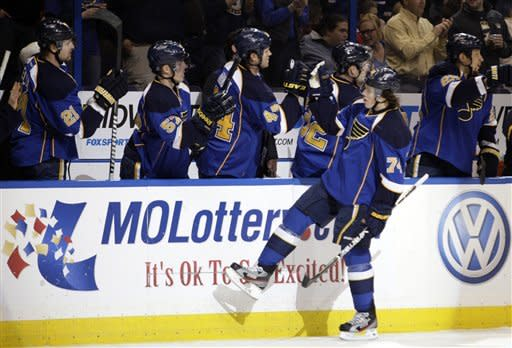St. Louis Blues' T.J. Oshie (74) celebrates with teammates after scoring a goal in the first period of an NHL hockey game against the Chicago Blackhawks, Tuesday, March 6, 2012 in St. Louis.(AP Photo/Tom Gannam)