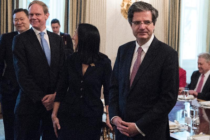 Britain's Ambassador to the United Nations Matthew Rycroft (2L) and France's Ambassador to the United National Francois Delattre (R) wait for a luncheon with UN Security Council member nations in the White House April 24, 2017 in Washington, DC