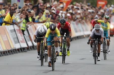 Cycling - Gold Coast 2018 Commonwealth Games - Women's Road Race - Currumbin Beachfront - Gold Coast, Australia - April 14, 2018. Chloe Hosking of Australia wins the race, with Georgia Williams of New Zealand in second and Danielle Rowe of Wales in third. REUTERS/Paul Childs