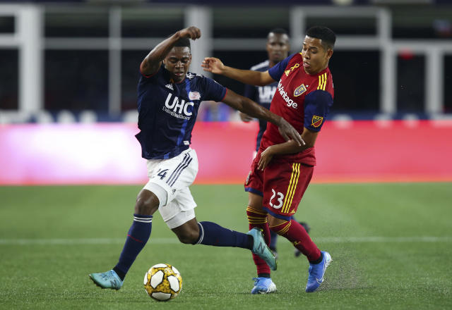 New England Revolution midfielder DeJuan Jones (24) and Real Salt Lake midfielder Sebastian Saucedo (23) battle for possession of the ball during the first half of an MLS soccer match at Gillette Stadium, Saturday, Sept. 21, 2019, in Foxborough, Mass. (AP Photo/Stew Milne)