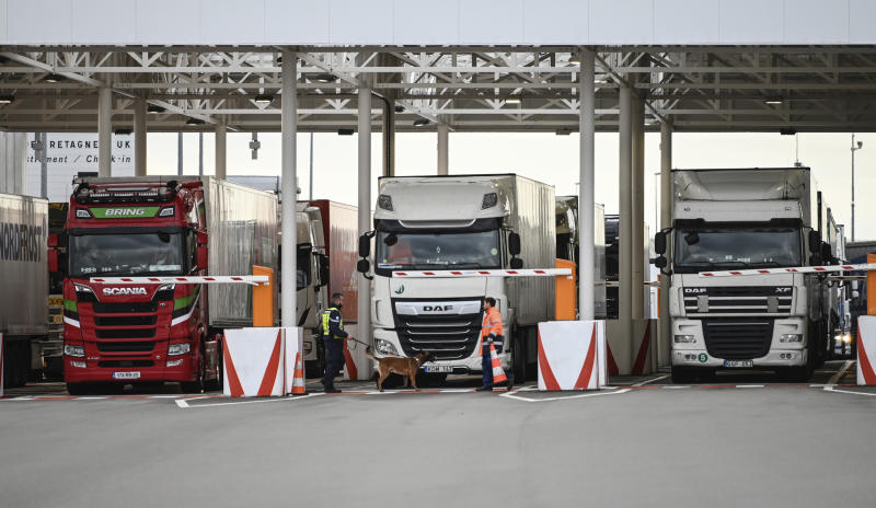 "FILE - In this Tuesday, Sept. 17, 2019 file photo, an employee of Eurotunnel and his dog check trucks on their way to Britain during a day of test in case of no deal Brexit, at the exit of the Channel tunnel in Calais, northern France. Britain's government watchdog says there is still a ""significant amount"" of work to do to ensure Britain has an adequate medicines supply in case of a no-deal Brexit. In a report issued on Friday, Sept. 27, the National Audit Office said additional shipping capacity chartered by the U.K. for sending goods across the English channel might not be operational until the end of November - one month after the Oct. 31 deadline. (Denis Charlet, Pool via AP, file)"