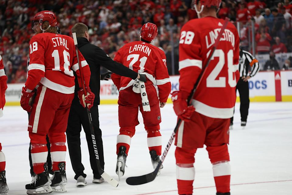 Detroit Red Wings center Dylan Larkin (71) is taken off the ice after punching Tampa Bay Lightning right wing Mathieu Joseph (7) during second-period action of the season opener at Little Caesars Arena Thursday, Oct. 14, 2021.