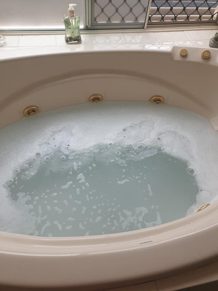 The bath was filled with products for a strip clean, and didn't looks as enticing after. Photo: Supplied