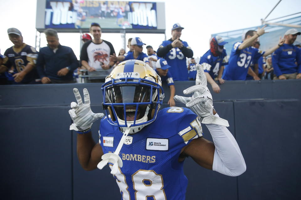Winnipeg Blue Bombers wide receiver Rasheed Bailey celebrates a touchdown by teammate Kenny Lawler against the Hamilton Tiger-Cats during the first half of a Canadian Football League game Thursday, Aug. 5, 2021, in Winnipeg, Manitoba. (John Woods/The Canadian Press via AP)