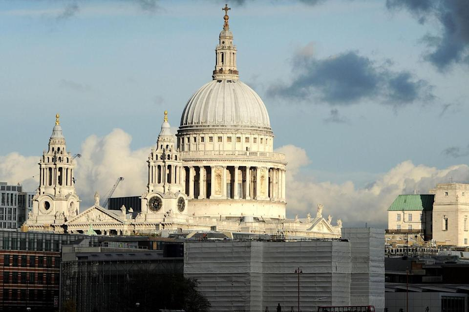 Unmarred: A clear view of the sky around the upper part of the dome of St Paul's: PA