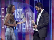 Ingrid Andress, left, presents the award for male artist of the year to Thomas Rhett at the 56th annual Academy of Country Music Awards on Sunday, April 18, 2021, at the Grand Ole Opry in Nashville, Te nn. (AP Photo/Mark Humphrey)