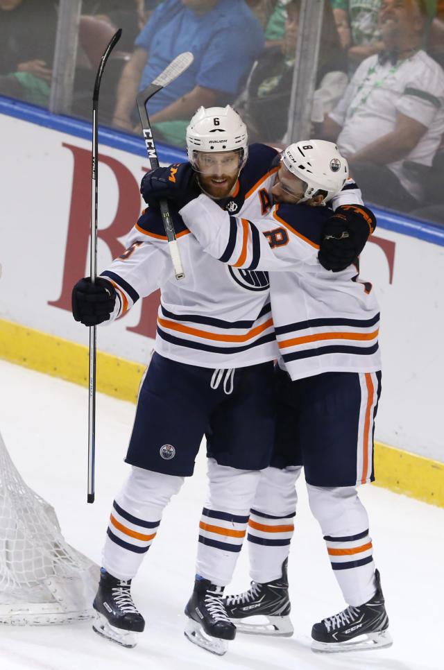 Edmonton Oilers defenseman Adam Larsson (6) celebrates his game-winning goal in the third period with teammate Ty Rattie (8) over the Florida Panthers during an NHL hockey game, Saturday, March 17, 2018, in Sunrise, Fla. The Oilers won the game 4-2. (AP Photo/Joe Skipper)