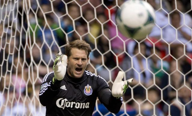 Chivas USA goalkeeper Dan Kennedy makes a save against the Vancouver Whitecaps FC during the first half of an MLS soccer game in Vancouver, British Columbia, Wednesday, June, 19, 2013. (AP Photo/The Canadian Press, Jonathan Hayward)