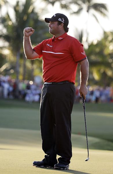 Patrick Reed celebrates his win at the Cadillac Championship golf tournament on Sunday, March 9, 2014, in Doral, Fla. (AP Photo/Lynne Sladky)