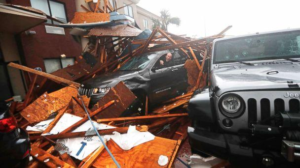PHOTO: A storm chaser climbs into his vehicle during the eye of Hurricane Michael to retrieve equipment after a hotel canopy collapsed in Panama City Beach, Fla., Oct. 10, 2018. (AP)