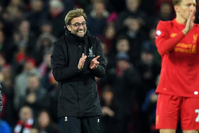 Liverpool's manager Jurgen Klopp celebrates on the pitch after the English Premier League football match between Liverpool and Manchester City at Anfield in Liverpool, north west England on December 31, 2016 (AFP Photo/Paul ELLIS)