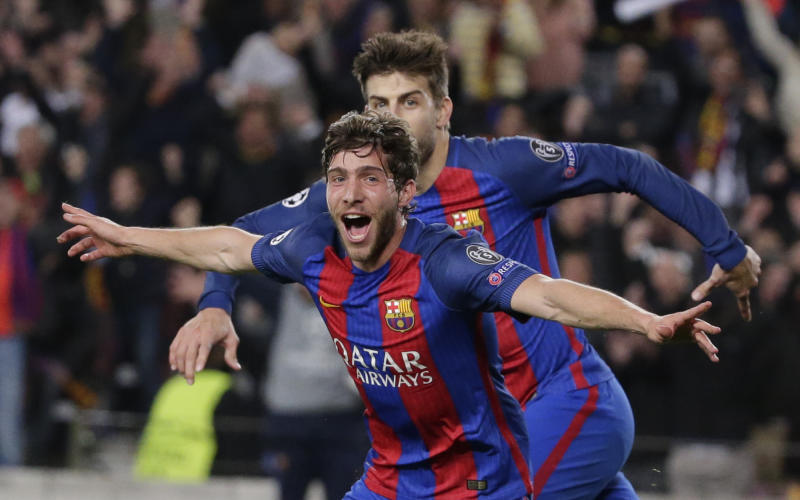 Barcelona's Sergi Roberto celebrates after scoring the sixth goal during the Champions League round of 16, second leg soccer match between FC Barcelona and Paris Saint Germain at the Camp Nou stadium in Barcelona, Spain, Wednesday March 8, 2017. Barcelona won 6-1. (AP Photo/Emilio Morenatti)