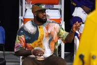 Los Angeles Lakers' LeBron James watches from the bench during the first half of an NBA basketball game between the Lakers and the Utah Jazz Saturday, April 17, 2021, in Los Angeles. (AP Photo/Mark J. Terrill)