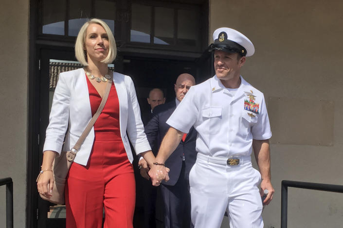 Navy Special Operations Chief Edward Gallagher leaves a military courtroom on Naval Base San Diego with his wife, Andrea Gallagher, Friday, May 31, 2019, in San Diego. The decorated Navy SEAL faces a murder trial in the death of an Islamic State prisoner. (AP Photo/Julie Watson)