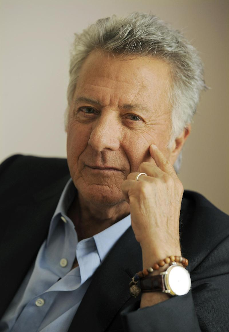 "FILE - In this Sept. 10, 2012 file photo, Dustin Hoffman, director of the film ""Quartet,"" poses for a portrait at the 2012 Toronto Film Festival, in Toronto. ""Quartet,"" which premiered at last September's Toronto International Film Festival, opened in a handful of theaters Jan. 11, 2013, and expands to wider release Friday. (Photo by Chris Pizzello/Invision/AP, File)"