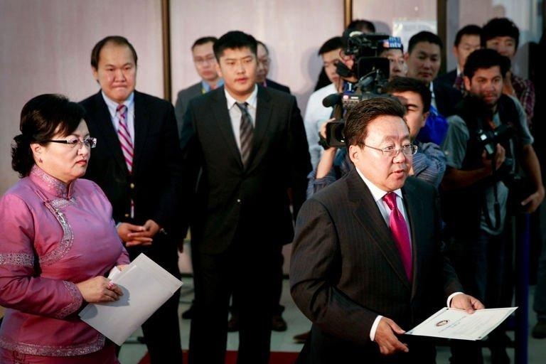 Mongolian President Tsakhia Elbegdorj (far right) votes at a polling station in Ulan Bator, on June 26, 2013. Mongolians are voting in a presidential election pitting the front-running incumbent against a champion wrestler and a woman, amid calls for a fairer distribution of the former Soviet satellite's spectacular mining wealth