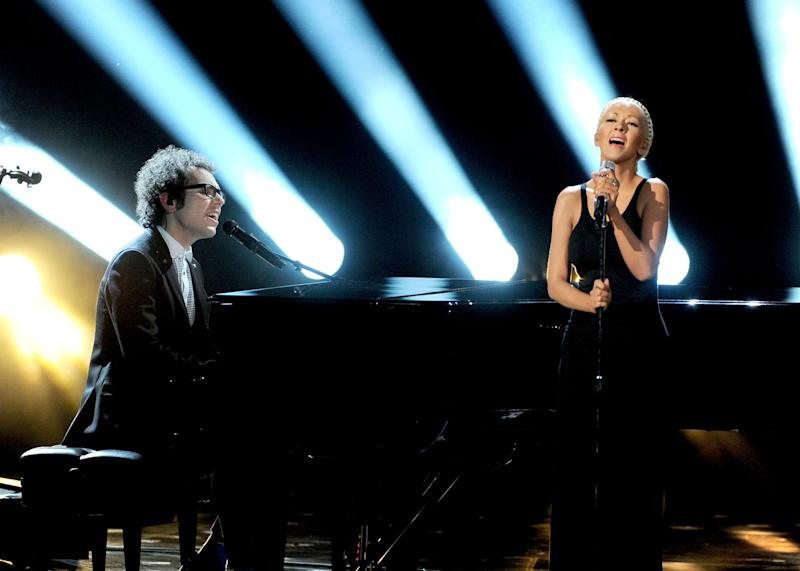 LOS ANGELES, CA - NOVEMBER 24: Musician Ian Axel of A Great Big World (L) and singer Christina Aguilera perform onstage during the 2013 American Music Awards at Nokia Theatre L.A. Live on November 24, 2013 in Los Angeles, California. (Photo by Kevin Winter/Getty Images)