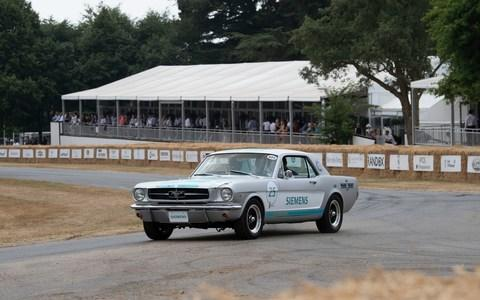 A Siemens converted 1966 Ford Mustang becomes the first autonomous car to drive up the famous Goodwood Hill climb as part of the 25th anniversary of the Festival of Speed in Sussex Friday July 013, 2018. Picture by Christopher Pledger for the Telegraph - Credit: Christopher Pledger