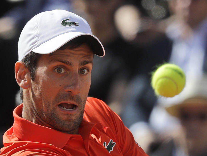 Novak Djokovic of Serbia returns the ball to Rafael Nadal of Spain during their final match at the Italian Open tennis tournament, in Rome, Sunday, May 19, 2019. (AP Photo/Gregorio Borgia)