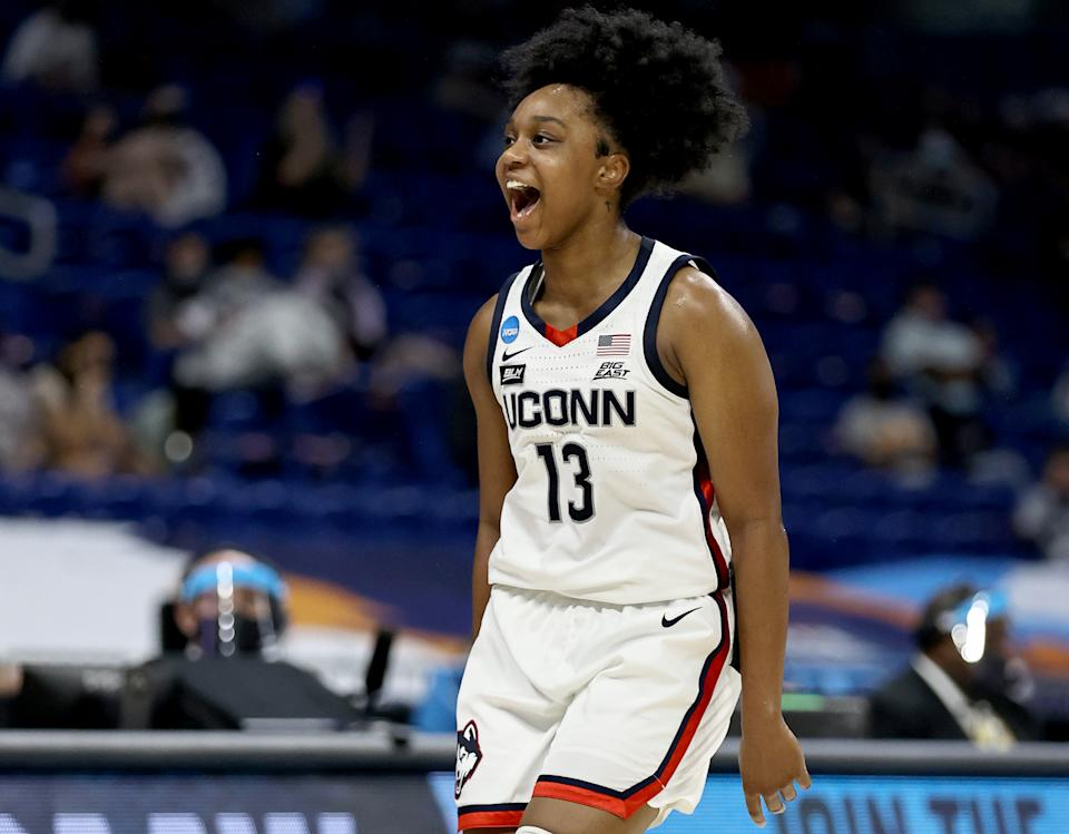 SAN ANTONIO, TEXAS - MARCH 27: Christyn Williams #13 of the UConn Huskies celebrates her three point shot in the first half against the Iowa Hawkeyes during the Sweet Sixteen round of the NCAA Women's Basketball Tournament at the Alamodome on March 27, 2021 in San Antonio, Texas. (Photo by Elsa/Getty Images)