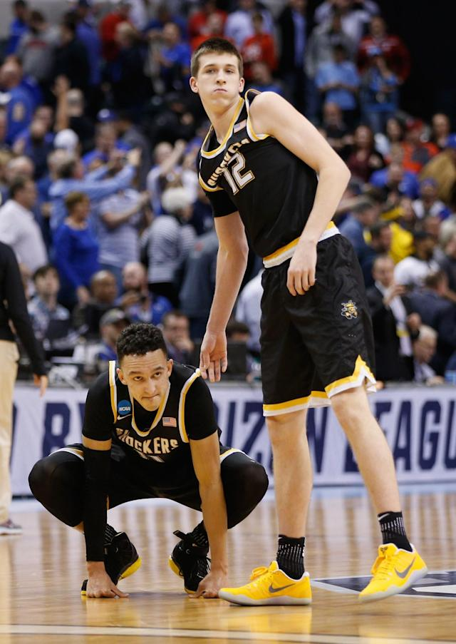 <p>Landry Shamet #11 of the Wichita State Shockers reacts to his missed shot the end of the game as teammate Austin Reaves #12 looks on in the second half against the Kentucky Wildcats during the second round of the 2017 NCAA Men's Basketball Tournament at the Bankers Life Fieldhouse on March 19, 2017 in Indianapolis, Indiana. The Kentucky Wildcats won 65-62.(Photo by Joe Robbins/Getty Images) </p>
