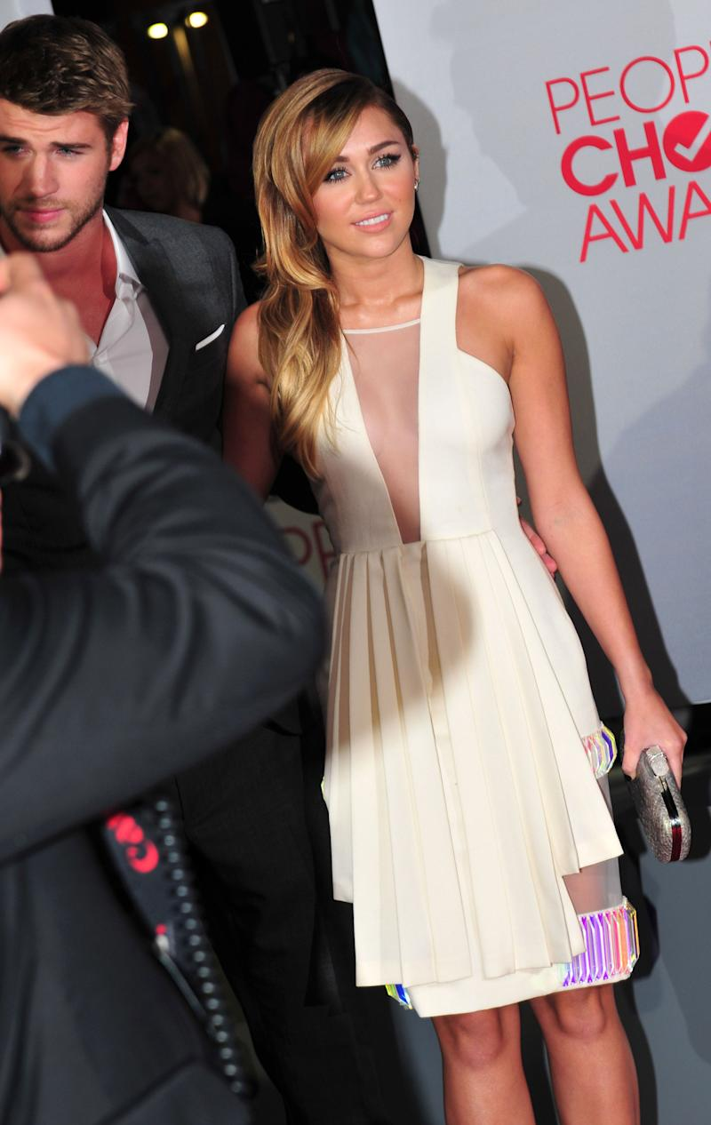 Miley Cyrus and Liam Hemsworth attend the People's Choice Awards