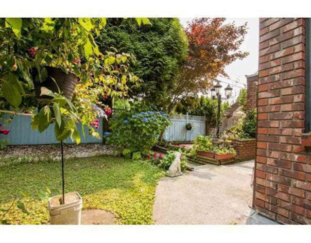 <p><span>783 Clark Rd., Coquitlam, B.C.</span><br> The backyard is fully fenced, and has three balconies looking out to the garden.<br> (Photo: Zoocasa) </p>