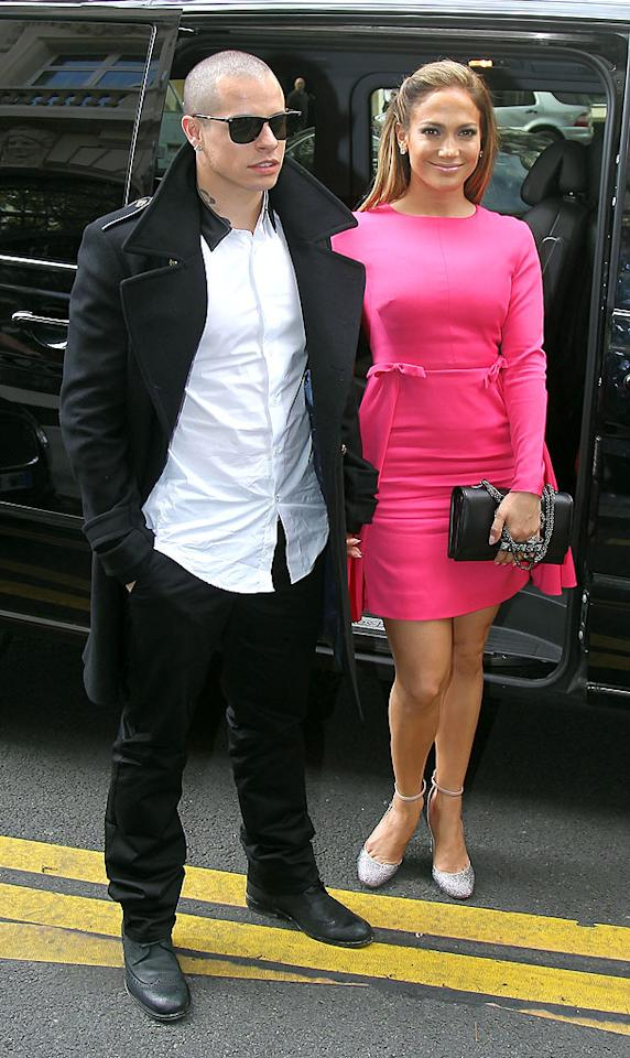 """If you can ignore Casper Smart's wrinkled shirt, popped collar, and neck tattoo, feast your eyes on his gal pal, former """"Idol"""" judge Jennifer Lopez, who appeared positively radiant in her bubblegum-pink Valentino mini (and silver ankle-strap pumps) while out and about in the City of Light. (10/2/2012)<br><br><a target=""""_blank"""" href=""""http://omg.yahoo.com/news/casper-smart-plays-dad-jennifer-lopezs-twins-140000446.html"""">How Casper plays dad to J.Lo's twins</a>"""