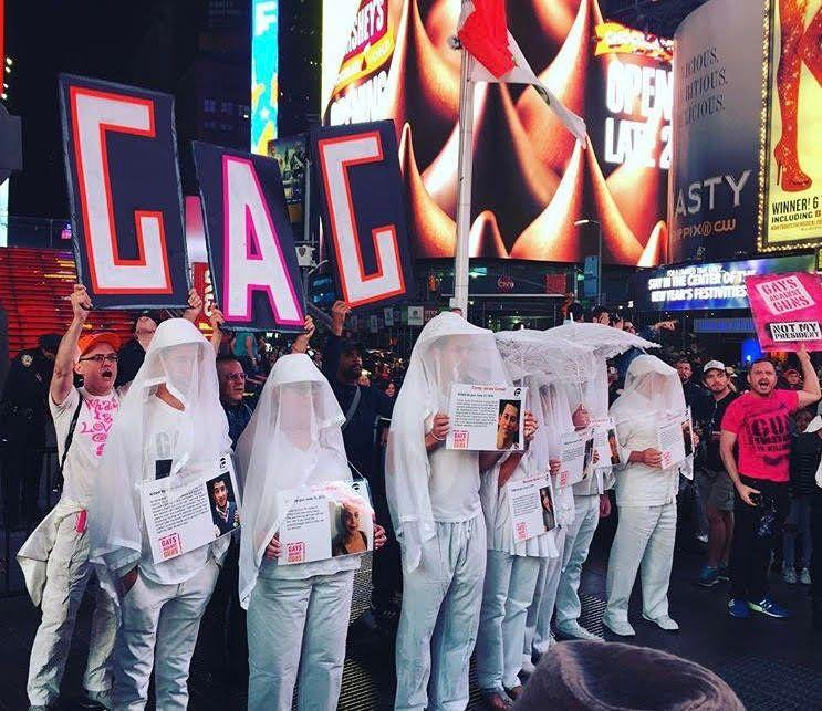 More than 100Gays Against Guns(GAG) protesters marched from New York's Union Square to Times Square Monday in honor of the 59 people killed in Sunday's mass shooting in Las Vegas.