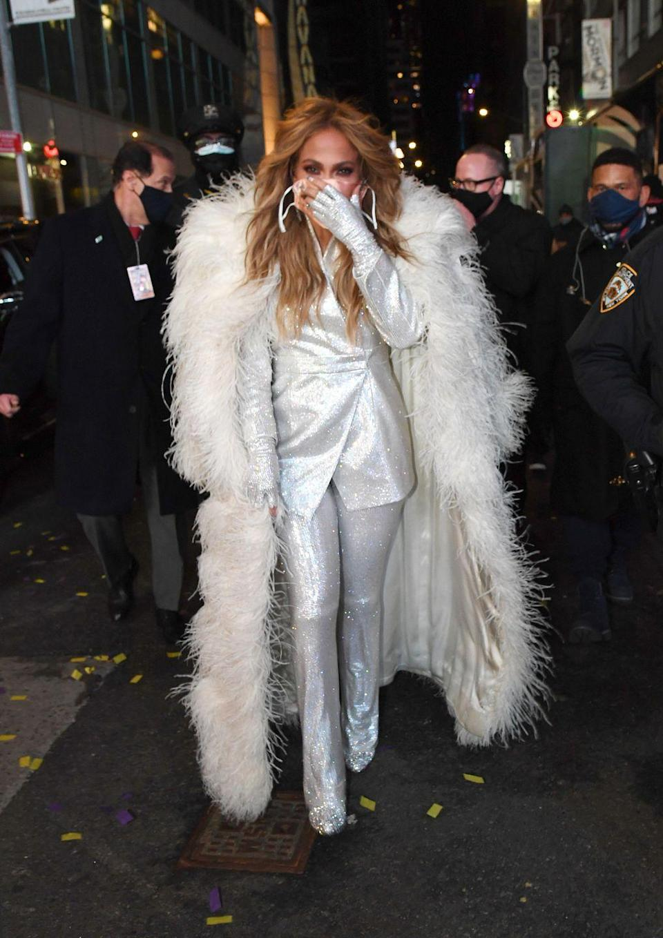 <p>Jennifer Lopez looked like she was ready to celebrate the end of 2020 (same Jennifer, same) as she walked to the stage for her New Years Eve performance in Times Square, New York City. </p><p>The singer wore a full silver trouser suit to ring in 2021, with matching boots, fingerless gloves and an ankle-length white, furry coat to keep warm in a very cold NYC. </p>
