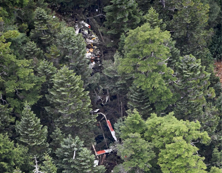 The wreckage of Gunma prefectural air rescue helicopter Haruna is seen after crashing in Nakanojo town, Gunma prefecture, northwest of Tokyo Friday, Aug. 10, 2018. The wreckage of the Japanese search and rescue helicopter with nine people aboard was found in central Japan mountains Friday hours after it lost contact, and two of them were found dead near the aircraft crash site. (Akiko Matsushita/Kyodo News via AP)