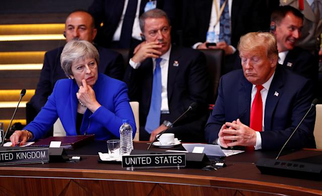 <p>British Prime Minister Theresa May and President Trump attend a meeting of the North Atlantic Council during a NATO summit in Brussels, July 11, 2018. (Photo: Francois Lenoir/Reuters) </p>