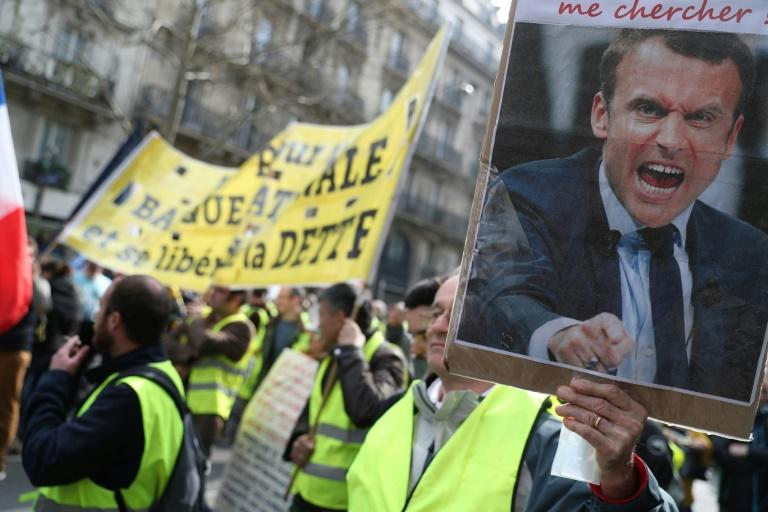 "The government said tens of thousands rallied across France on the 19th weekend of ""yellow vest"" protests"